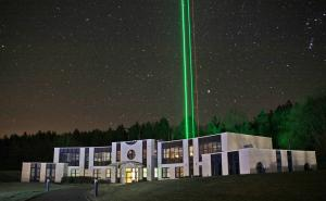 Laser pointing skywards from research institute